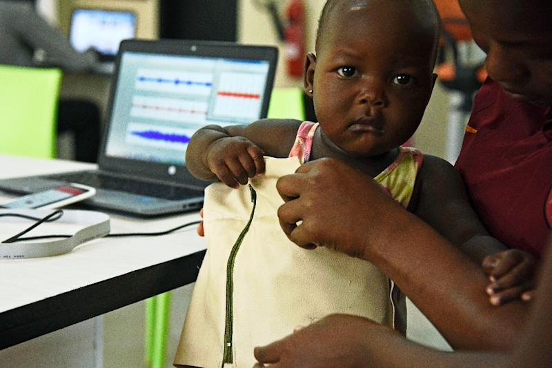 """The """"Mama-Ope"""" (Mother's Hope) kit, invented by Ugandan engineers, is a biomedical smart jacket and a mobile phone app that diagnoses pneumonia faster than a doctor (AFP Photo/ISAAC KASAMANI)"""