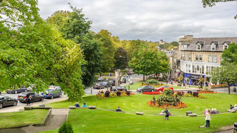 People enjoying the garden in the town centre in Harrogate UK