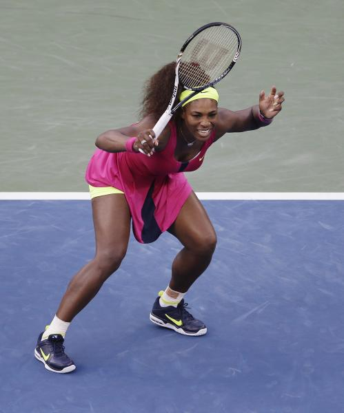 Serena Williams reacts while playing Italy's Sara Errani during a semifinal match at the 2012 US Open tennis tournament, Friday, Sept. 7, 2012, in New York. Williams won the match. (AP Photo/Mike Groll)