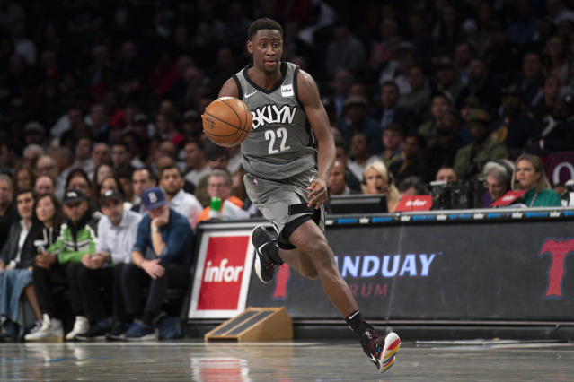 "The <a class=""link rapid-noclick-resp"" href=""/nba/teams/brooklyn/"" data-ylk=""slk:Nets"">Nets</a> are still in the playoff field without <a class=""link rapid-noclick-resp"" href=""/nba/players/5651/"" data-ylk=""slk:Caris LeVert"">Caris LeVert</a> and <a class=""link rapid-noclick-resp"" href=""/nba/players/4840/"" data-ylk=""slk:Kyrie Irving"">Kyrie Irving</a>. How much can those two players returning help? (AP Photo/Mary Altaffer)"
