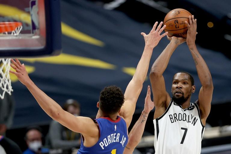 Brooklyn's Kevin Durant puts up a shot over Michael Porter in the Nets' 125-119 come-from-behind NBA victory over the Denver Nuggets