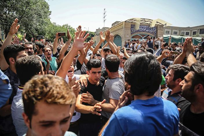 """In this June 25, 2018 file photo, a group of protesters chant slogans at the main gate of the Old Grand Bazaar, in Tehran, Iran. <p class=""""copyright"""">Iranian Labor News Agency via Associated Press</p>"""