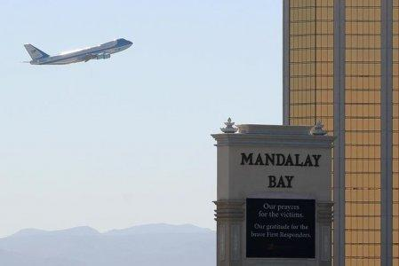 FILE PHOTO: Air Force One departs Las Vegas past the a sign in front of Mandalay Bay hotel where shooter Stephen Paddock conducted his mass shooting along the Las Vegas Strip in Las Vegas, Nevada, U.S., October 4, 2017. REUTERS/Mike Blake