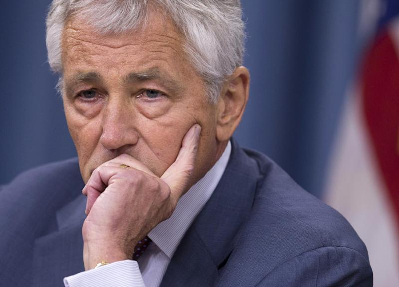 FILE - In this July 31, 2013 file photo, Defense Secretary Chuck Hagel pauses during a news conference at the Pentagon in Washington. Hagel is suggesting Friday, Aug. 23, 2013, that the Pentagon is moving naval forces closer to Syria in case President Barack Obama decides to order military strikes. (AP Photo/Evan Vucci, File)