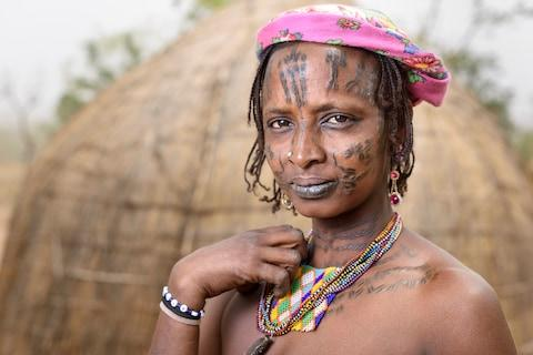 An Mbororo woman with scarification - Credit: GETTY
