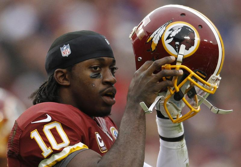 File of Washington Redskins quarterback Griffin III putting his helmet back on after being tackled by the Baltimore Ravens defense in the first half of their NFL football game in Landover, Maryland