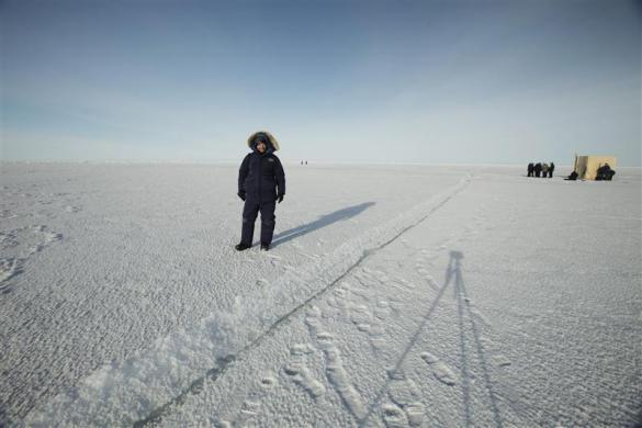 Reuters photographer Lucas Jackson takes a self portrait while waiting for a nuclear submarine to surface through the ice near the Applied Physics Lab Ice Station in the Arctic north of Prudhoe Bay, Alaska March 19, 2011.