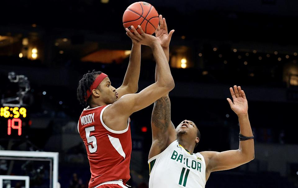 Moses Moody #5 of the Arkansas Razorbacks shoots over Mark Vital #11 of the Baylor Bears during the second half in the Elite Eight round of the 2021 NCAA Men's Basketball Tournament at Lucas Oil Stadium.