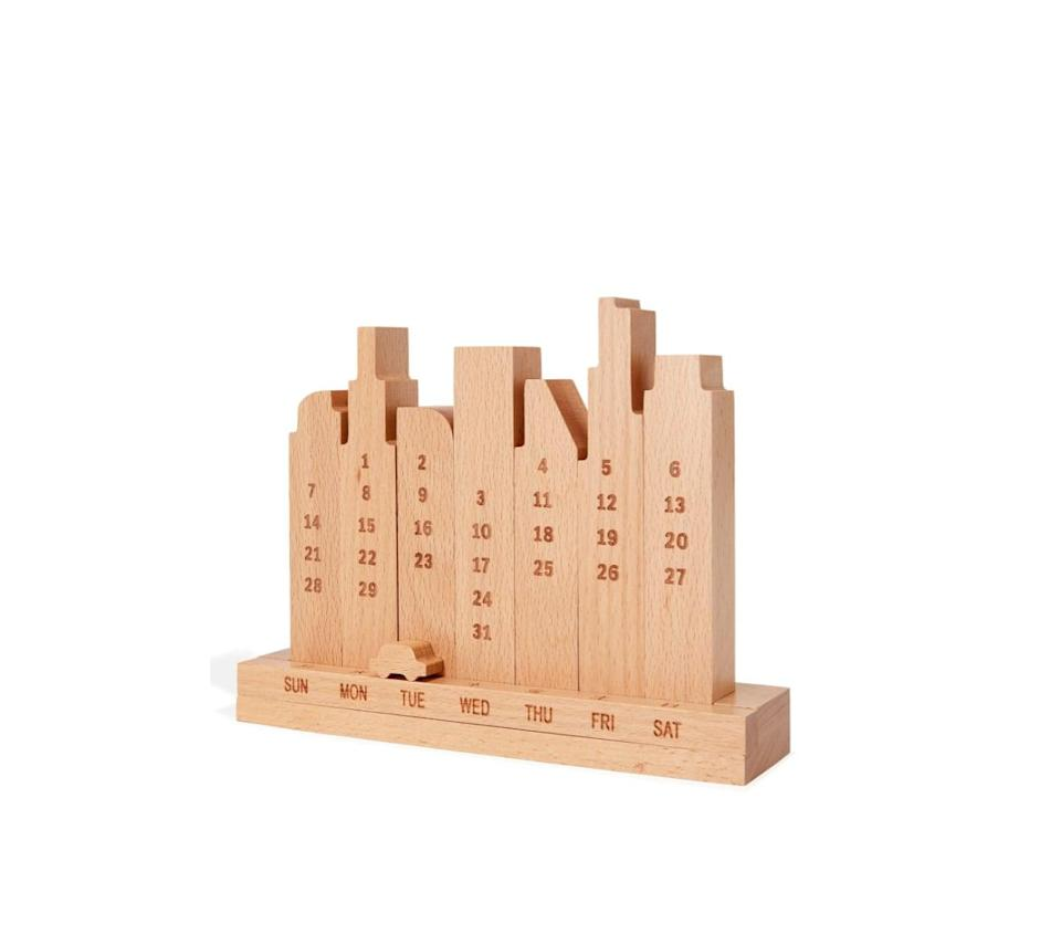 <p>After spending a year and some change in real-life Groundhog Day, you can use a calendar to keep you on schedule. This <span>City Perpetual Wood Calendar</span> ($45) is practical and pretty in equal measure.</p>