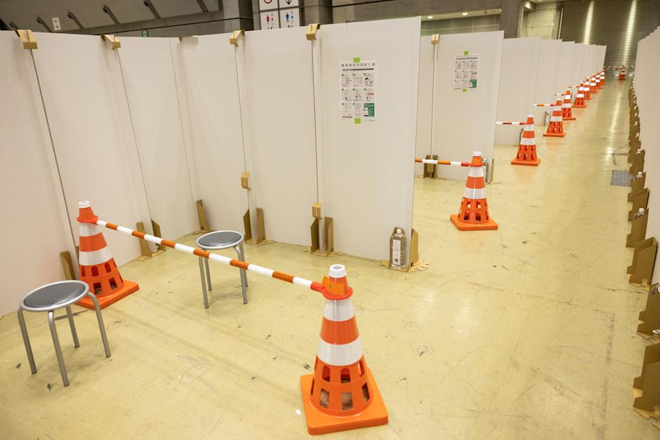 <p>Rows of partitioned cubicles for members of the media to provide spit samples for Covid-19 tests are seen on day two of the Tokyo 2020 Olympic Games at Nippon Budokan on July 25, 2021 in Tokyo, Japan.</p>