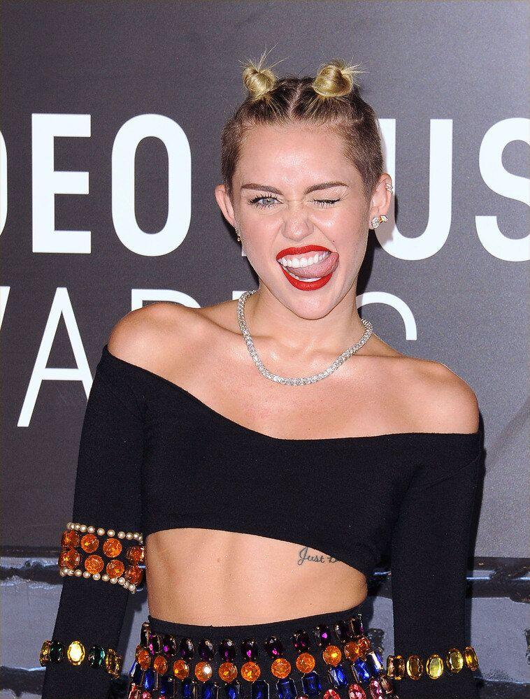 """Miley might have provided one of the most outrageous moments in VMAs history back in 2013, but it's often overlooked that she actually left the ceremony early. Hinting on Twitter that something may be afoot, she wrote: """"Leaving the VMAs. No it's not over. I'm no psychic but congrats @onedirection #songofthesummer"""" Call her Mystic Meg, because 1D only went and won, didn't they? We're sure it was just a coincidence..."""