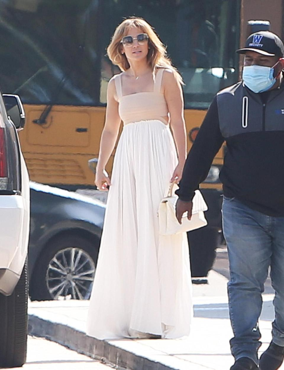 <p>Jennifer Lopez steps out in a floaty maxi dress (and that signature J.Lo glow) while out and about on June 3 in L.A. </p>
