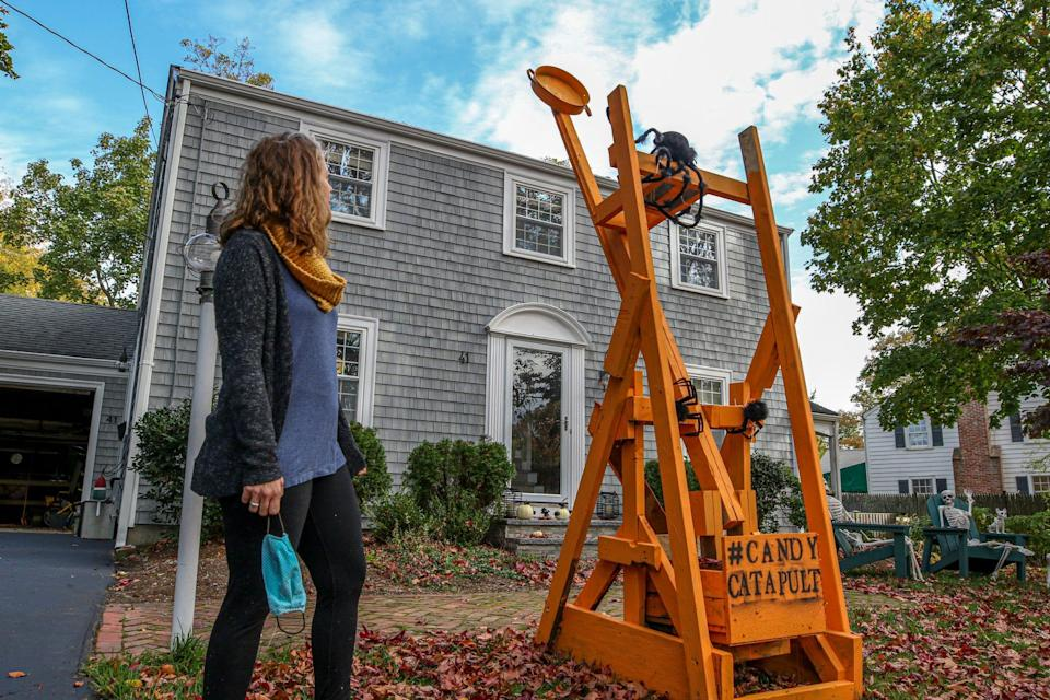 Barrington, Rhode Island mom Lindsey Hingorany takes no credit for the building of this candy catapult that her husband and sons erected for Halloween visitors.