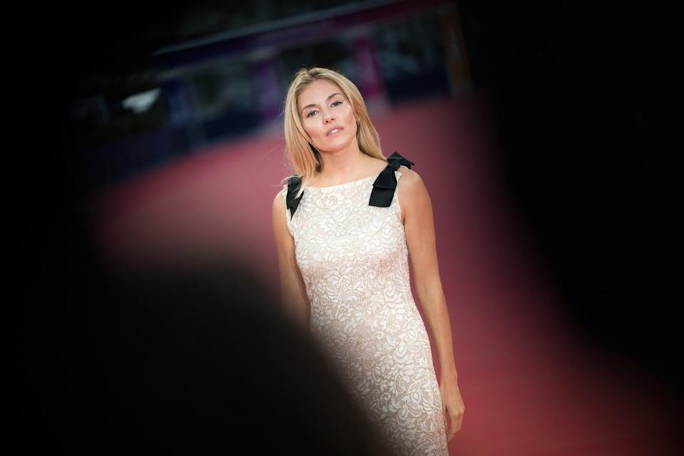 "<div class=""inline-image__caption""><p>Sienna Miller poses on the red carpet as she arrives to receive an homage during the 45th Deauville US Film Festival on September 11, 2019. </p></div> <div class=""inline-image__credit"">Loic Venance/AFP/Getty</div>"