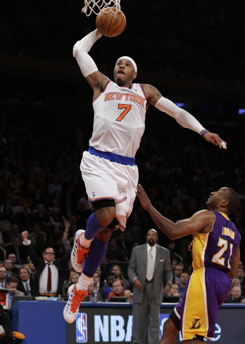 New York Knicks forward Carmelo Anthony (7) goes up for a layup over Los Angeles Lakers guard Chris Duhon (21) in the first half of their NBA basketball game at Madison Square Garden in New York, Thursday, Dec. 13, 2012.  The Knicks defeated the Lakers 116-107. (AP Photo/Kathy Willens)
