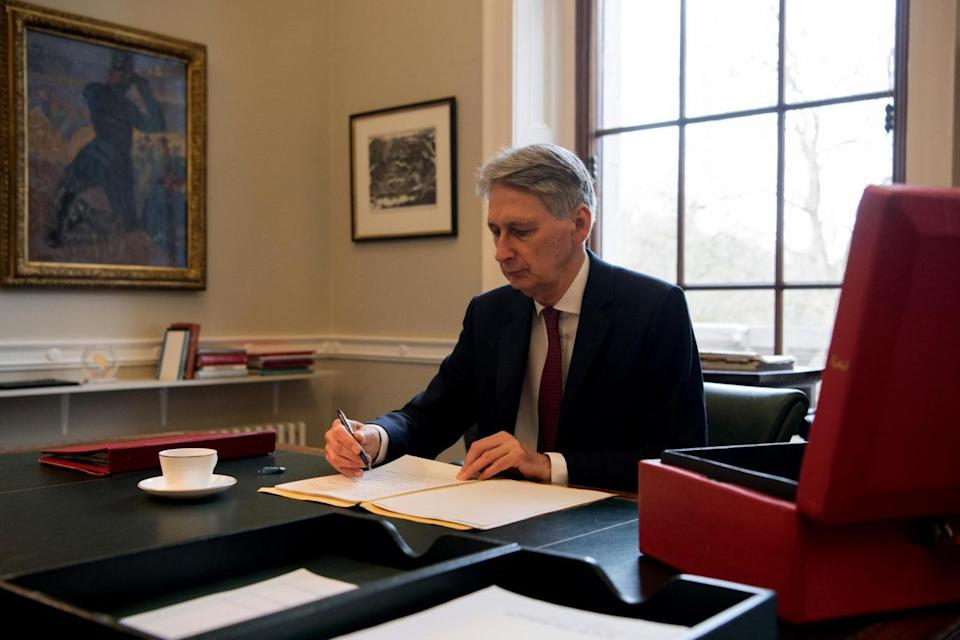 Chancellor: Mr Hammond preparing his speech in his office at the Treasury ahead of March's Budget (Getty Images)