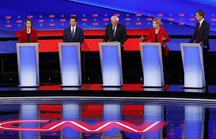 From left, Sen. Amy Klobuchar, D-Minn., South Bend Mayor Pete Buttigieg, Sen. Bernie Sanders, I-Vt., Sen. Elizabeth Warren, D-Mass., and former Texas Rep. Beto O'Rourke participate in the first of two Democratic presidential primary debates hosted by CNN Tuesday, July 30, 2019, in the Fox Theatre in Detroit. (AP Photo/Paul Sancya)
