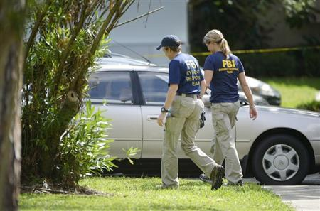 FBI personnel walk through the complex surrounding the apartment, where Ibragim Todashev was shot and killed by FBI, in Orlando