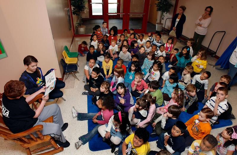 Children on the autistic spectrum gather to read storybooks at a New Jersey school.  (Photo: AP)