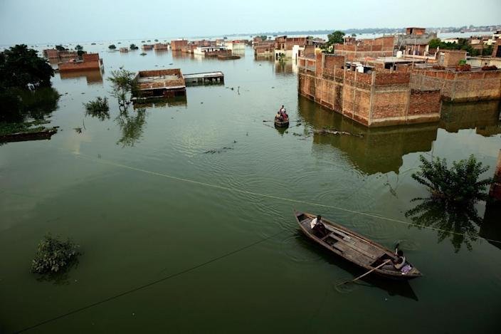 <p>Flood affected people move to safer place in Allahabad, India, Thursday, Aug. 25, 2016. Flood affected move to safer places, in Allahabad, India, Thursday, Aug. 25, 2016. (AP Photo/Rajesh Kumar Singh)</p>