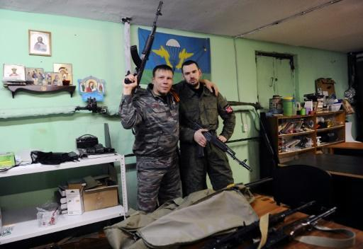 Members of the Russian Imperial Movement who are volunteers of the self-declared Donetsk People's Republic pose with weapon simulators at a training base in Saint Petersburg in 2015