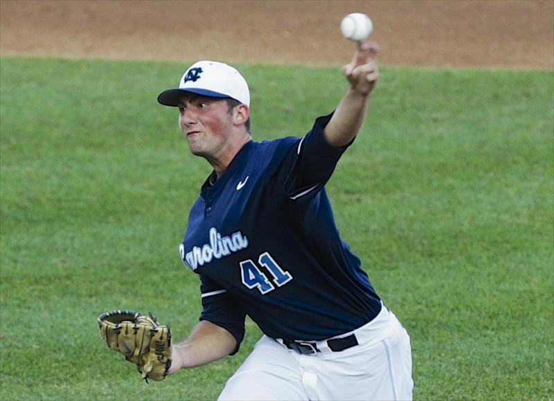 North Carolina starting pitcher Kent Emanuel delivers against UCLA in the first inning of an NCAA College World Series baseball game in Omaha, Neb., Friday, June 21, 2013. (AP Photo/Nati Harnik)
