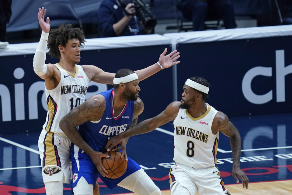 LA Clippers center DeMarcus Cousins is double-teamed by New Orleans Pelicans center Jaxson Hayes (10) and forward Naji Marshall (8) in the second half of an NBA basketball game in New Orleans, Monday, April 26, 2021. The Pelicans won 120-103. (AP Photo/Gerald Herbert)