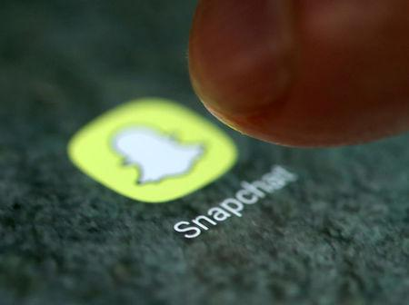 FILE PHOTO: The Snapchat app logo is seen on a smartphone in this illustration