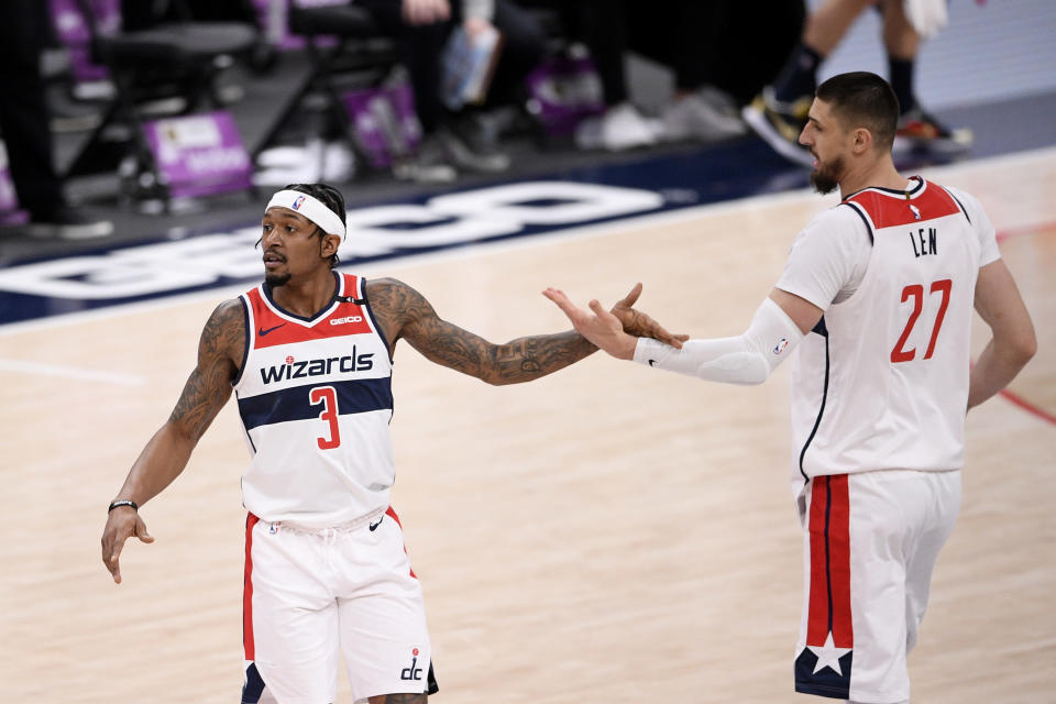 Washington Wizards guard Bradley Beal (3) and center Alex Len (27) react during the first half of an NBA basketball game against the Denver Nuggets, Wednesday, Feb. 17, 2021, in Washington. (AP Photo/Nick Wass)