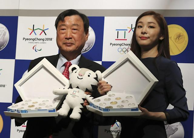 <p>Former South Korean Olympic figure skating champion Yuna Kim, right, and President of the PyeongChang Organizing Committee Lee Hee-beom pose for the media as they hold the commemorative coins for the 2018 Winter Olympic Games during tis launching ceremony in Seoul, South Korea, Thursday, Sept. 22, 2016. South Korea's Pyeongchang will host the Winter Olympics games which will start in Feb. 2018. (AP Photo/Lee Jin-man) </p>