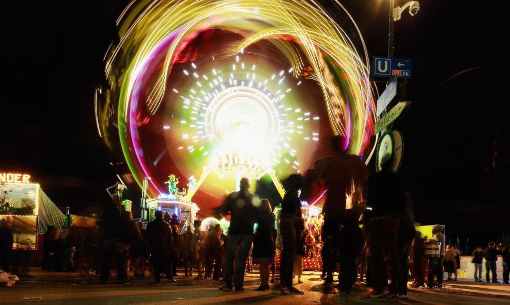 People are drawn to a luminous merry-go-round at the Oktoberfest in Munich, Germany. The fairgrounds come alive in the evenings with folk and pop music performances and, of course, more beer.