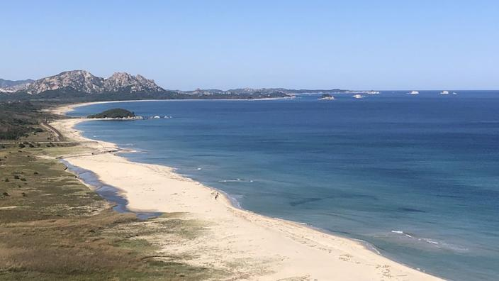 Large sandy beach looking north from the Geosong Observatory