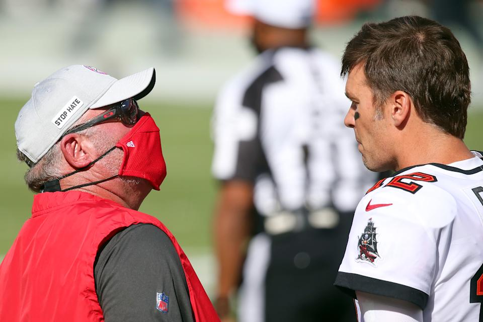Bucs Head coach Bruce Arians talks with quarterback Tom Brady (12) before the regular season game between the Green Bay Packers and the Tampa Bay Buccaneers on October 18, 2020 at Raymond James Stadium in Tampa, Florida. (Photo by Cliff Welch/Icon Sportswire via Getty Images)
