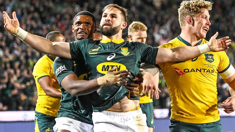 South Africa's Cobus Reinach celebrates after scoring a try against Australia. (Photo by CHRISTIAAN KOTZE/AFP/Getty Images)