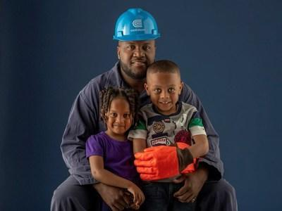 """Kevin Hyde, a mechanic in Environmental Operations, with his daughter Kailyn and his son Kavon. Kevin Hyde says: """"My work at Con Edison makes it possible for our field crews to perform their jobs safely. We are all united around our goal of providing safe, reliable energy service to our customers."""""""