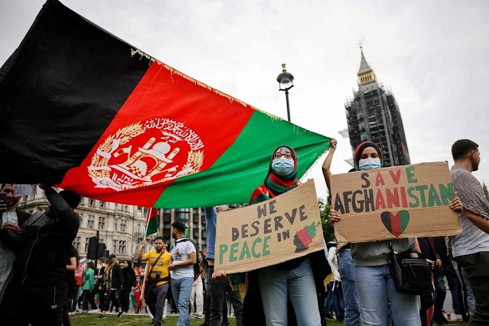 Crowds gathered at Parliament Square, Oxford Circus and Hyde Park (AFP via Getty Images)