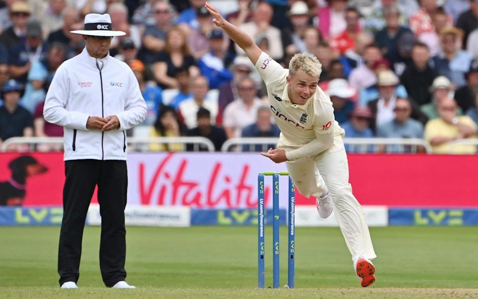 England's Sam Curran bowls on the second day of the first cricket Test match of the India Tour of England 2021 between England and India at Trent Bridge - PAUL ELLIS/AFP via Getty Images