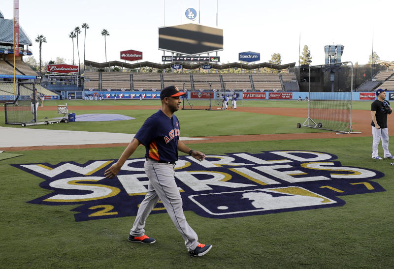 Houston Astros bench coach Alex Cora walks across the field in Los Angeles during media day for baseball's World Series against the Los Angeles Dodgers. Current Boston Red Sox manager Alex Cora has led Boston