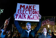 """FILE - In this Nov. 5, 2020, file photo, Jake Contos, a supporter of President Donald Trump, chants during a protest against the election results outside the central counting board at the TCF Center in Detroit. President Donald Trump and his allies have fomented the idea of a """"rigged election"""" for months, promoting falsehoods through various media and even lawsuits about fraudulent votes and dead voters casting ballots. While the details of these spurious allegations may fade over time, the scar it leaves on American democracy could take years to heal. (AP Photo/David Goldman, File)"""