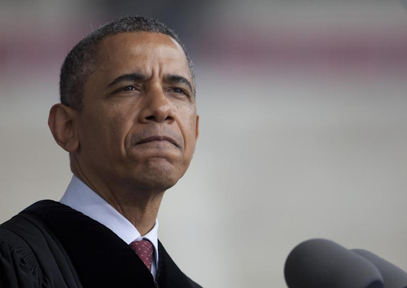President Barack Obama pauses as he speaks at Ohio State University's spring commencement in the Ohio Stadium, Sunday, May 5, 2013,  in Columbus, Ohio. President Obama is the third sitting president to give the commencement speech at Ohio State University.  (AP Photo/Carolyn Kaster)