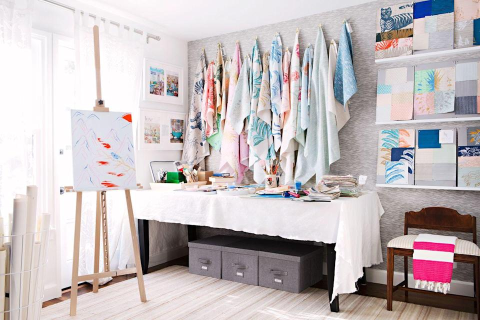 """<p>Craft rooms tend to accumulate tons of scraps. Bring in bins and boxes to stay organized and keep clutter to a minimum (or at least out of plain sight). Take note from <a href=""""https://www.housebeautiful.com/design-inspiration/house-tours/g19660926/sharon-lee-house-tour/?slide=4"""" rel=""""nofollow noopener"""" target=""""_blank"""" data-ylk=""""slk:this craft room"""" class=""""link rapid-noclick-resp"""">this craft room</a> in Sharon Lee's Santa Monica bungalow and tuck them under a table. </p>"""