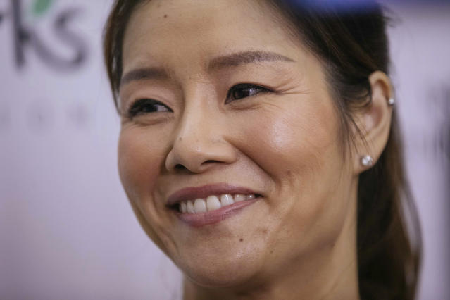 Two-time Grand Slam champion Li Na smiles while talking to the media at the Sutton East Tennis Club Thursday, July 18, 2019, in New York. Li Na will be inducted into the Tennis Hall of Fame on Saturday, July 20. (AP Photo/Kevin Hagen)