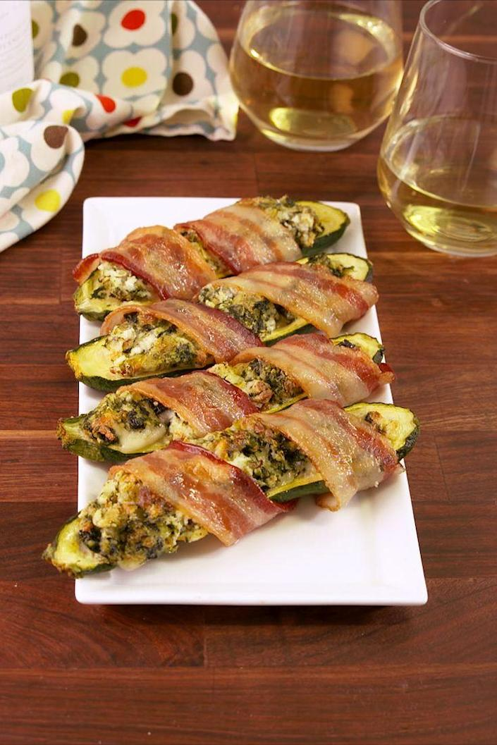 """<p>Creamy, salty and delicious.</p><p>Get the recipe from <a href=""""https://www.delish.com/cooking/recipe-ideas/recipes/a58198/bacon-wrapped-stuffed-zucchini-recipe/"""" rel=""""nofollow noopener"""" target=""""_blank"""" data-ylk=""""slk:Delish"""" class=""""link rapid-noclick-resp"""">Delish</a>. </p>"""