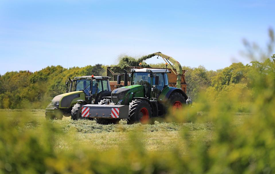Tractors at work in a field (PA Archive)