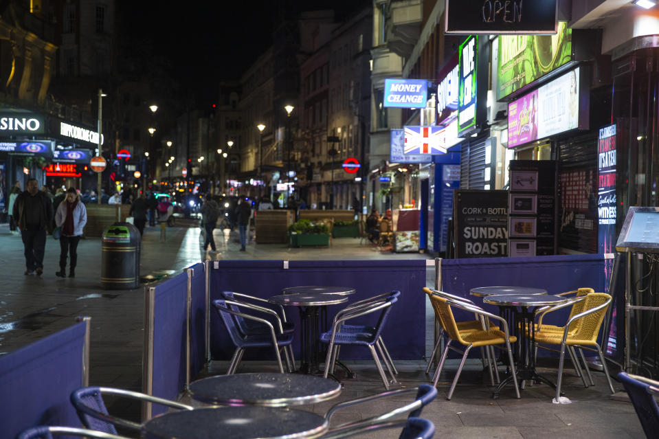Empty seats outside a restaurant in Piccadilly Circus, London, as a further 14 patients who tested positive for the coronavirus have died bringing the death toll in the UK to 35. (Photo by Hollie Adams/PA Images via Getty Images)