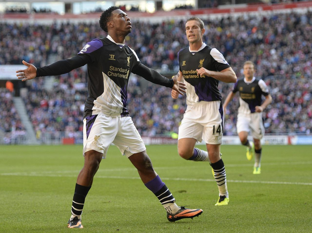 """Liverpool's Daniel Sturridge (L) celebrates scoring against Sunderland during their English Premier League soccer match at The Stadium of Light in Sunderland, northern England, September 29, 2013. REUTERS/Nigel Roddis (BRITAIN - Tags: SPORT SOCCER) FOR EDITORIAL USE ONLY. NOT FOR SALE FOR MARKETING OR ADVERTISING CAMPAIGNS. NO USE WITH UNAUTHORIZED AUDIO, VIDEO, DATA, FIXTURE LISTS, CLUB/LEAGUE LOGOS OR """"LIVE"""" SERVICES. ONLINE IN-MATCH USE LIMITED TO 45 IMAGES, NO VIDEO EMULATION. NO USE IN BETTING, GAMES OR SINGLE CLUB/LEAGUE/PLAYER PUBLICATIONS"""