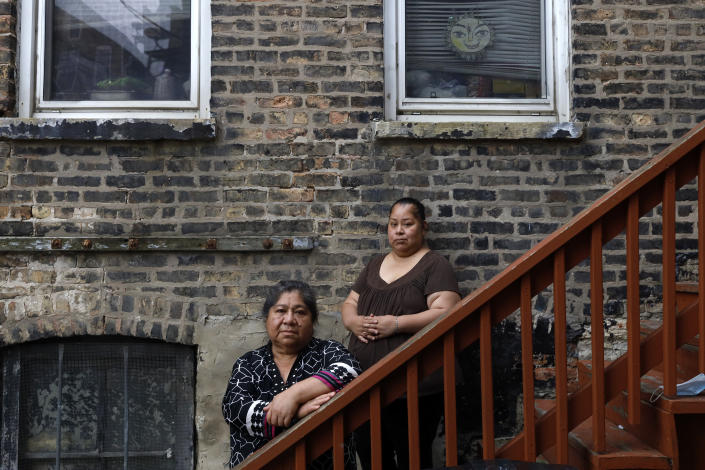 Maria Elena Estamilla, 62, left and her daughter Esmeralda Triquiz pose for a photo June 30, 2021, in Chicago's Pilsen neighborhood. Estamilla's last full medical exam was in 2015 and she sees no options for care as a Mexican immigrant without legal permission to live in the U.S. She's not eligible for Medicare, Medicaid or Affordable Care Act coverage. As a child care worker, she didn't have employer coverage and can't afford private insurance. (AP Photo/Shafkat Anowar)