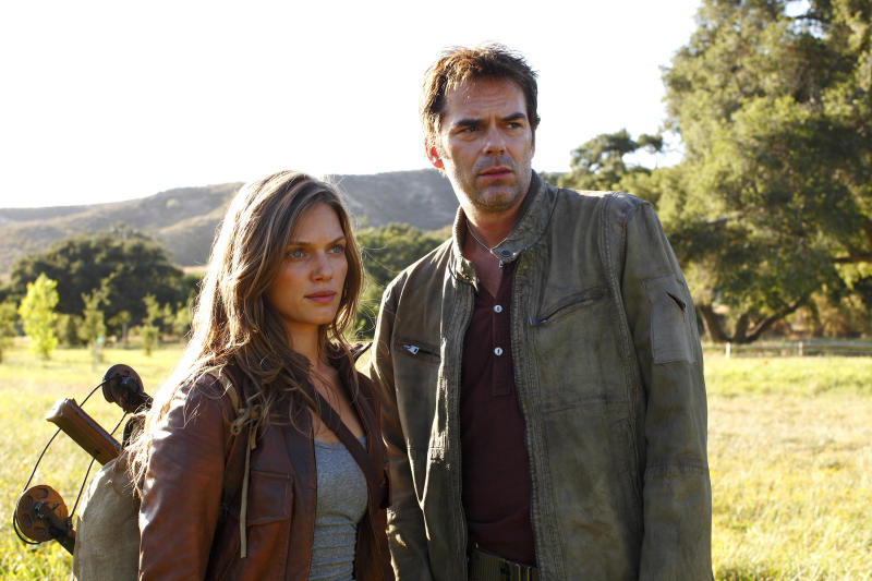 """This image released by NBC shows Tracy Spiridakos as Charlie Matheson, left, and Billy Burke as Miles Matheson from the new series """"Revolution,"""" that premiered Sept. 17 on NBC. (AP Photo/NBC, Trae Patton)"""