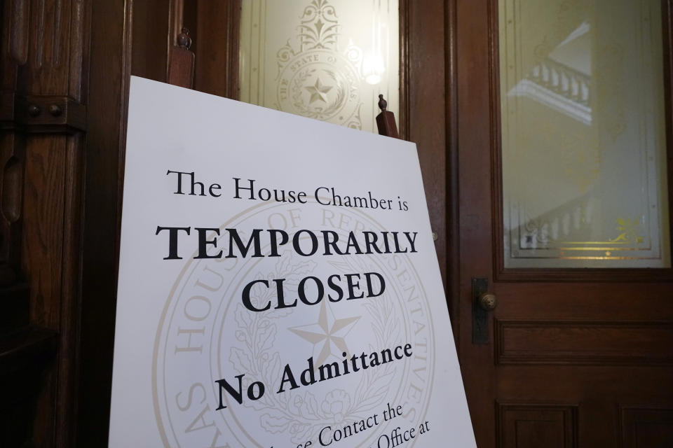 A closed sign blocks entry to the House Chamber at the State Capitol, Tuesday, June 1, 2021, in Austin, Texas. The Texas Legislature closed out its regular session Monday, but are expected to return for a special session after Texas Democrats blocked one of the nation's most restrictive new voting laws with a walkout. (AP Photo/Eric Gay)