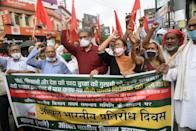 General secretary of CPI-ML Dipankar Bhattacharya demonstrating with party supporters at Dak Bungalow crossing in protest against recently passed farm bills, on September 25, 2020 in Patna, India. The two bills - the Farmers (Empowerment and Protection) Agreement on Price Assurance and Farm Services Bill, 2020 and the Farming Produce Trade and Commerce (Promotion and Facilitation) Bill, 2020 - were passed by the Rajya Sabha despite uproar and strong protest by the Opposition parties in the house. (Photo by Santosh Kumar/Hindustan Times via Getty Images)